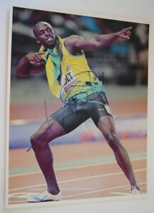 Usain-Bolt-Signed-Autographed-11x14-Photo-Jamaica-Olympic-Sprinter-COA-VD