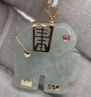 14 Karat Yellow Gold Natural Jade Elephant Pendant With Red Ruby. 26mm