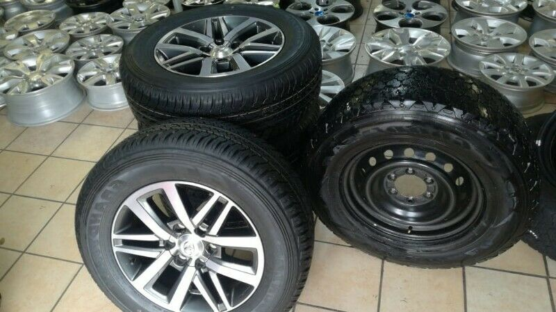 """18"""" Toyota Hilux/Fortuner original mags with brand new 265/60/18 Dunlop AT set for R13999."""