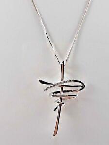 5d1c53138f Dettagli su Collana con pendente croce stilizzata da donna in oro bianco 18  kt e diamanti na