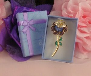 BOXED GOLD PLATED PURPLE MULTI COLOUR DIAMANTE CRYSTAL ROSE FLOWER BROOCH PIN - <span itemprop='availableAtOrFrom'>NOTTINGHAM, Nottinghamshire, United Kingdom</span> - If you have any problems with your purchase please contact me before leaving feedback. Damaged items will always be replaced or money refunded however please make cont - <span itemprop='availableAtOrFrom'>NOTTINGHAM, Nottinghamshire, United Kingdom</span>