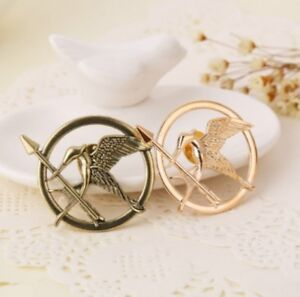 Hunger-Games-Mockingjay-Pin-Badge-Brooch-Bronze-Silver-or-Gold-Colour