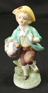 Vintage Bisque Porcelain Figurine Boy With Basket of Grapes