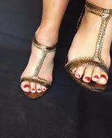 Well worn women's gold and  black stillettoes sandals size 8 very worn