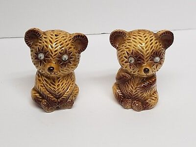 vintage ceramic squirrel and bear salt and pepper shakers with squiggly eyes