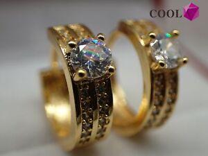 Solide-Princess-Huggies-Ohrringe-aus-18-Karat-Gelbgold-mit-Diamanten