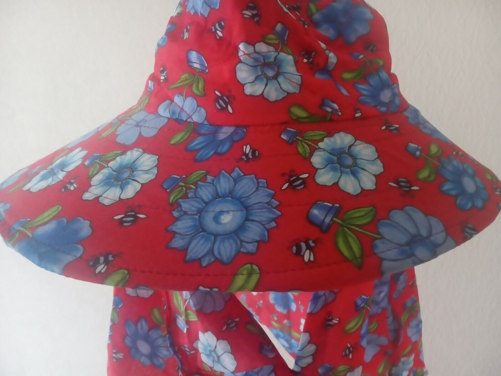 red flower hat face mecl covered