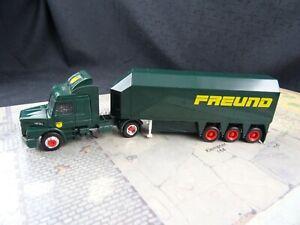 Herpa-Scania-Hauber-143-M-HF-FREUND-Glastransporter-1-87-BRE127