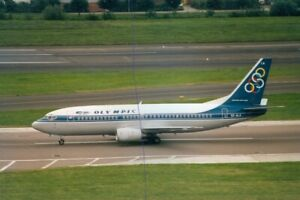 CIVIL AIRCRAFT PHOTO OLYMPIC PLANE PHOTOGRAPH BOEING 737 PICTURE 5X-BLA AIRLINER