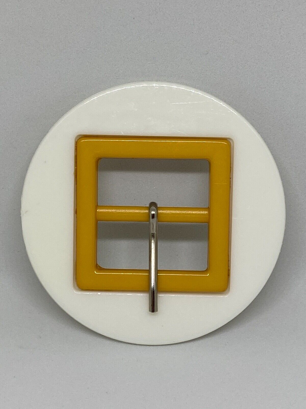 Woman`s white, plastic. Italy, belt buckle