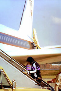 ELVIS-PRESLEY-BOARDING-LISA-MARIE-PLANE-TCB-LOGO-KANSAS-KS-6-19-77-CANDID-PHOTO
