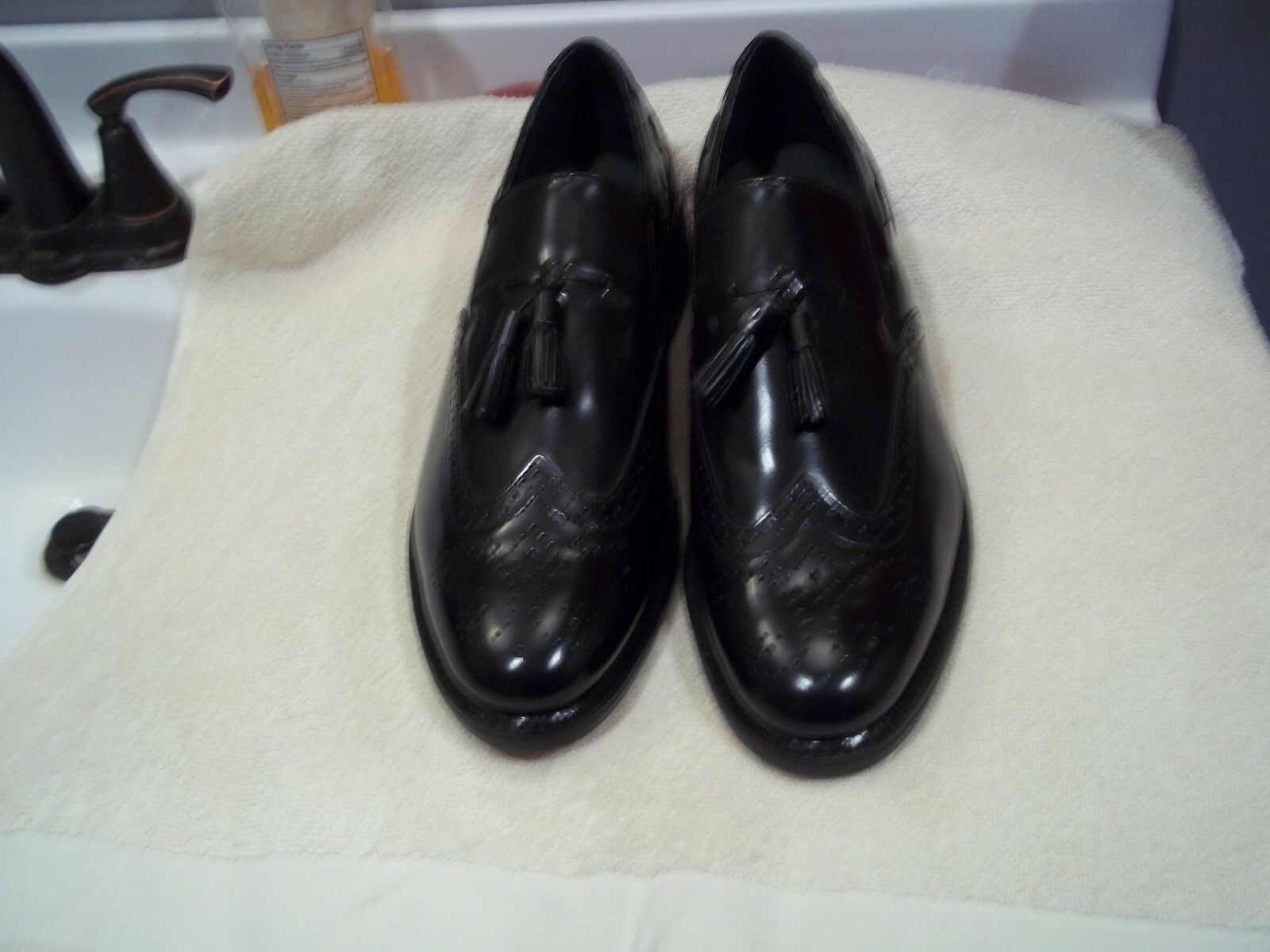 A PAIR OF BLACK TASSELL EXECUTIVE IMPERIALS WINGTIP LOAFERS SIZE 13=3E.