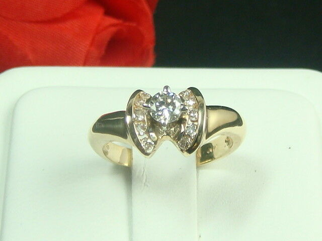 14K yellow gold diamond engagement ring with a round shape diamond