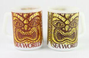 Vintage-Sea-World-Tiki-Face-Set-2-Federal-Milk-Glass-Tea-Souvenir-Coffee-Mugs
