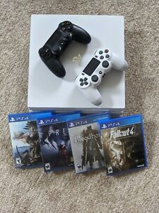 Sony PS4 Pro 1TB Video Game Console - Glacier White - 2 Controllers - 4 Games