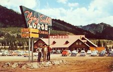 "THE FLYING SADDLE Clinger Lodge ALPINE, WY.  3 ""dudes"" under sign circa 1955"