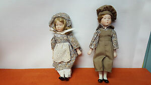 Pair-of-Matching-Dolls-Porcelain-Heads-Arms-and-Legs
