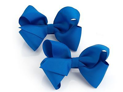 Girls Two Piece Navy Blue Bows Hair Clip Set.