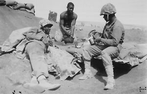 WWII-photo-American-Marines-rest-on-the-shore-of-Iwo-Jima-46i