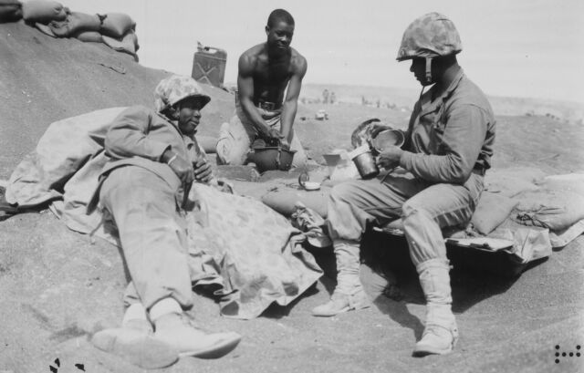 WWII photo American Marines rest on the shore of Iwo Jima 46i