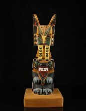 "A Vintage North American Carved Wood Totem Pole, Signed ""R. G. Huxley""."