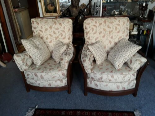pair of his and hers ercol armchairs
