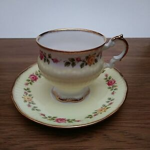 Elizabethan Footed Teacup & Saucer yellow with roses Delicate Urn Shape- Cottage