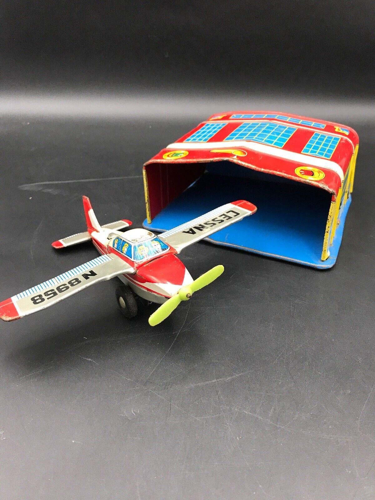 Vintage Marx Tin Litho Hanger and Vintage Tin Friction Cessna Airplane