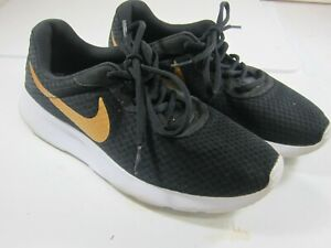 08541c655 Nike Tanjun Womens Size 9 Black Metallic Gold Synthetic Running ...
