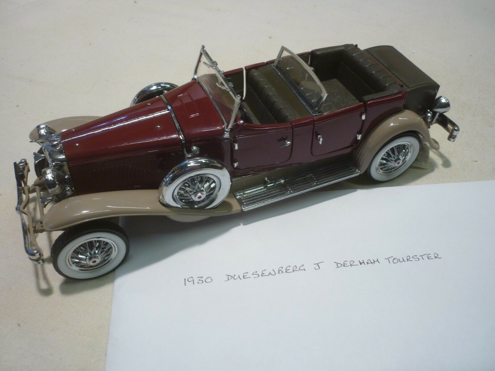 A Franklin mint, 1930 Duesenberg J Derham tourester, paper work, display case