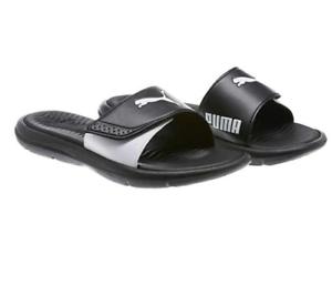 58b1389ad252 Brand New Puma Women s Surfcat Slide Slip On Sandals Black   White ...