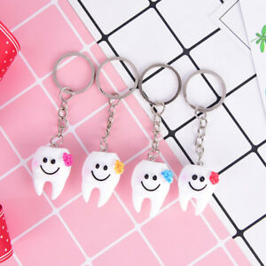 2Pcs-Simulation-tooth-pendant-keychain-small-promotional-gifts-Dental-Hospita-NT