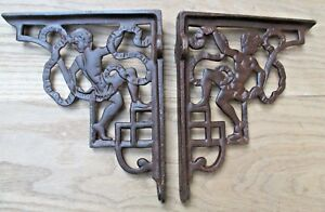 Paire-de-style-antique-cherubin-fonte-etagere-parentheses-CITERNE-crochet