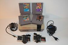 0004 Nintendo NES console + 2 controllers + Adventure Island 1 2 Airwolf Marble