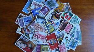 Worldwide-stamp-accumulation-kiloware-2-oz-around-900-off-paper-stamps-AC203
