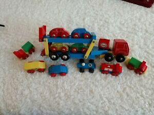 Vtg-Wooden-Car-Carrier-Truck-with-a-set-of-10-various-colored-trucks-cars