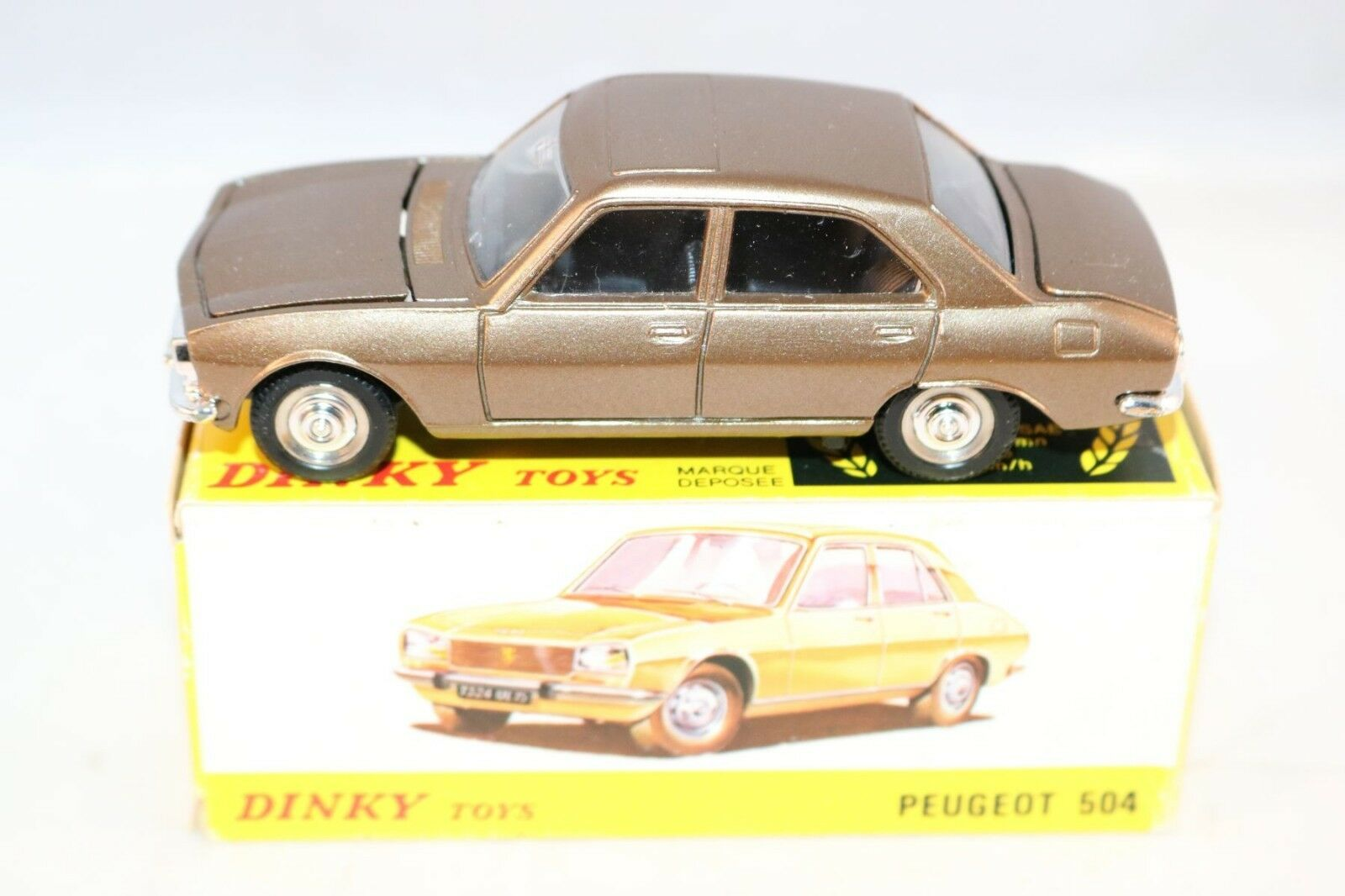 Dinky Toys 011452 Peugeot 504 bronze perfect mint in a super box what a beauty