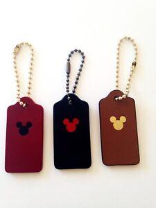 DISNEY-x-COACH-Monogrammed-Mickey-Hangtag-Key-Charm-NEW