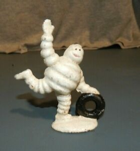 MICHELIN TIRE MAN FIGURINE ROLLING TIRE Cast Iron Paperweight Promo Advertising