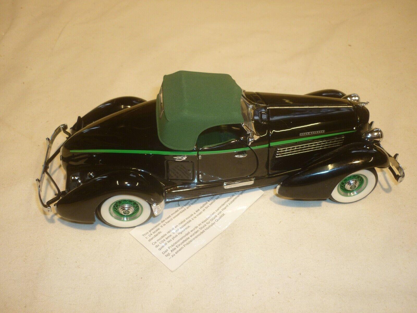 A Franklin mint scale model  of a 1935 Auburn 851 speedster boattail, no box  parfait