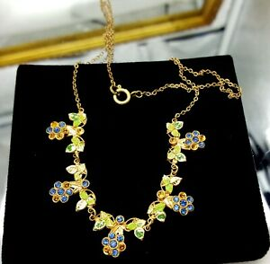Vintage-gold-tone-and-blue-rhinestones-necklace