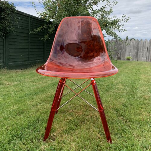 Three Eames Style Transparent Polycarbonate Chairs