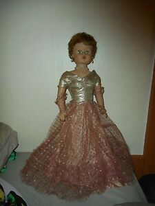 Vintage Doll In Golden Dress and Jewelry Marked 205