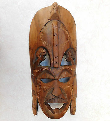 Vintage tribal mask Hand carved wooden wall plaque Childrens heads and tattoos