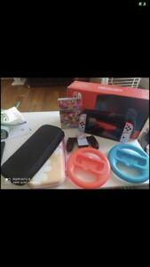 Nintendo Switch 32 Go Console Portable avec Manettes Joy-Con Bleu Néon/Rouge...