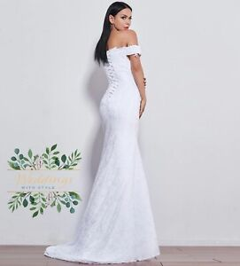 beautiful lace wedding dress form fitting off the