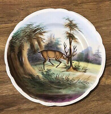 A pair of 19 Century german porcelain deer plates