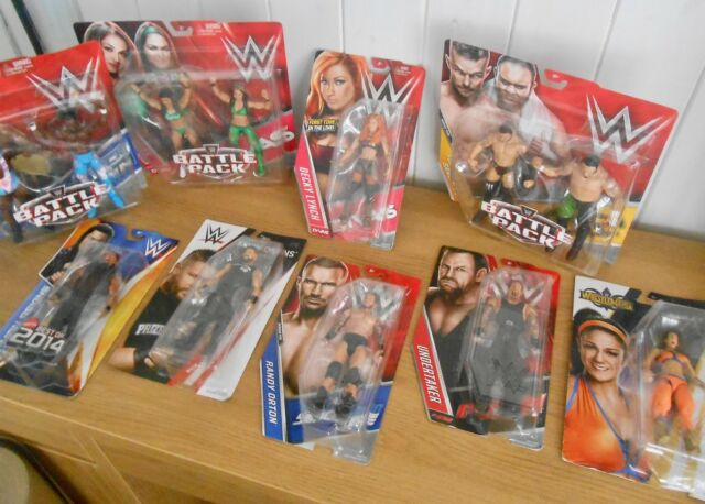 Set of 3 WWE wrestling figures inc  Roman Reigns, Dean Ambrose, The  Undertaker