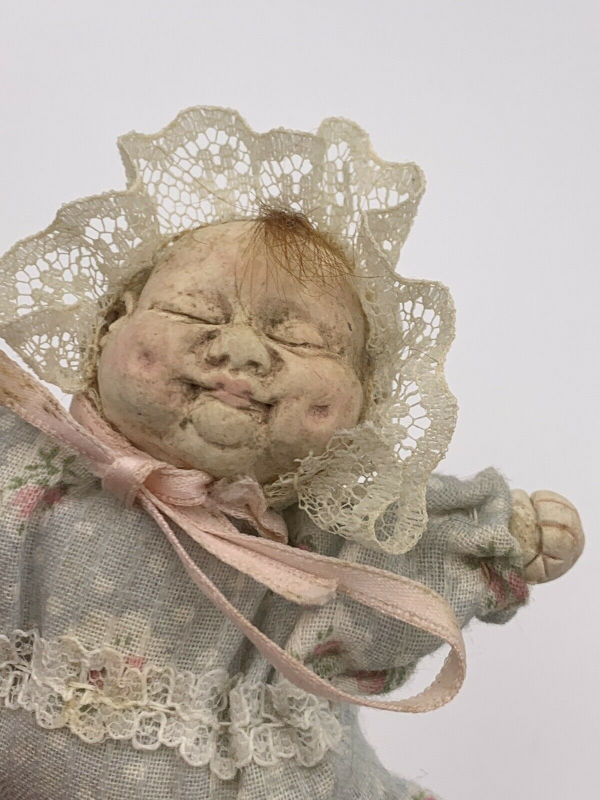 Antique Or Vintage Miniature Baby Doll In Woven Basket-   Extremely Ugly Baby