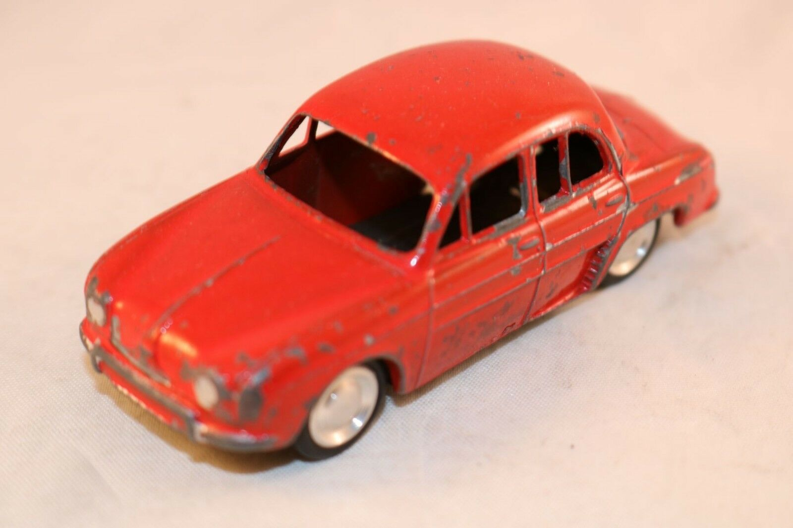 Lion Car Renault Dauphine red in good plus original condition made in Holland
